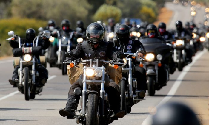 Members of the Rebels motorcycle gang ride to Perth on September 12, 2013 in Australia. Victoria, Queensland and New South Wales are cracking down on bikie gangs with new laws and a national anti-gangs squad. (Paul Kane/Getty Images)