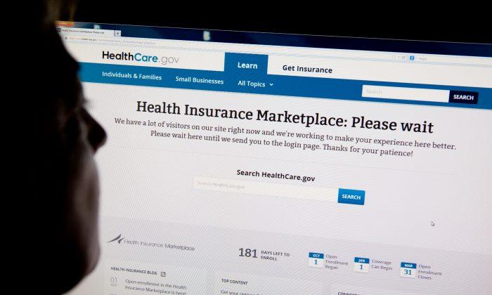 A woman looks at the HealthCare.gov insurance exchange internet site October 1, 2013 in Washington, DC. (Karen Bleier/AFP/Getty Images)