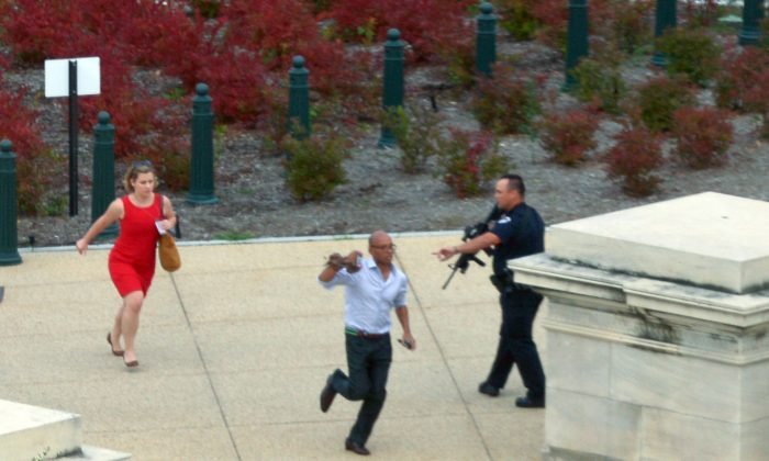 The situation in Washington D.C. on Thursday may have been a false flag, according to Alex Jones. Here, people run for cover as police converge to the site of a reported shooting October 3, 2013 on Capitol Hill in Washington, DC. (Mandel Ngan/AFP/Getty Images)