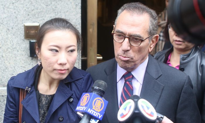 Comptroller John Liu's former treasurer, Jenny Hou (L), exits the United States District Court in Manhattan with her lawyer, Jarold Lefcart, in New York, Oct. 10, 2013. (Gary Du/Epoch Times)