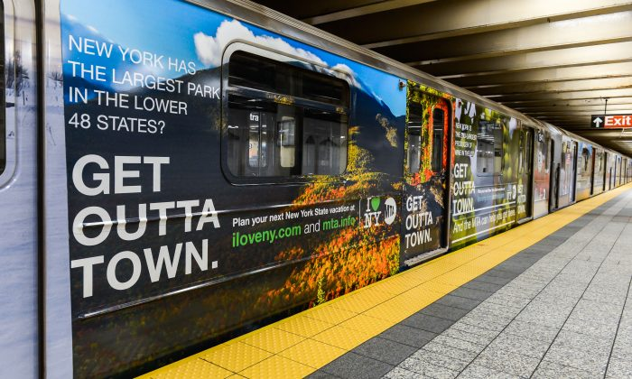 A subway shuttle train is wrapped in advertising for the I Love NY campaign in Manhattan, New York, Oct. 21, 2013. (Darren McGee/Courtesy of Empire State Development)