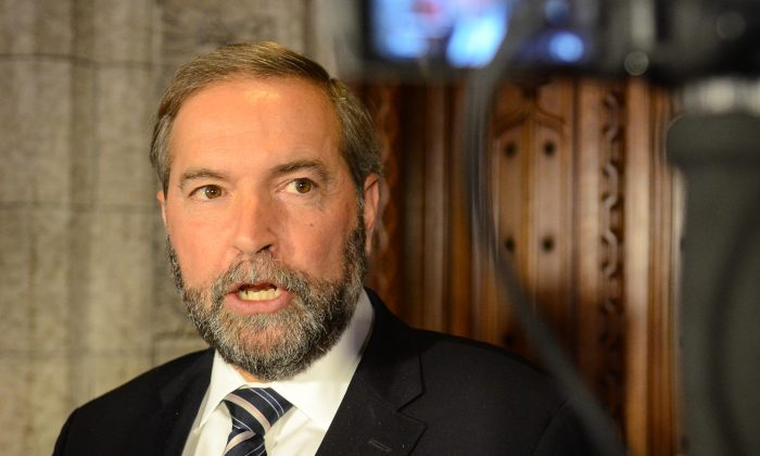 NDP leader Thomas Mulcair told reporters Wednesday that the Conservative government is offering an imitation of many NDP policies among the priorities laid out in the throne speech. (Matthew Little/Epoch Times)