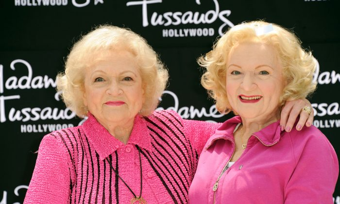 Betty White, left, attends her wax figure unveiling at Madame Tussauds on Monday, June 4, 2012, in Los Angeles. (Katy Winn/Invision/AP)