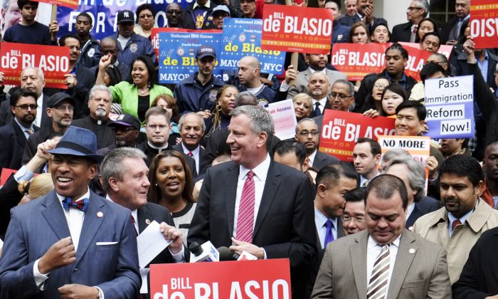 Democratic mayoral candidate Bill de Blasio addresses advocates at an immigration rally on the steps of City Hall on Oct. 23, 2013 in New York City. (Epoch Times)