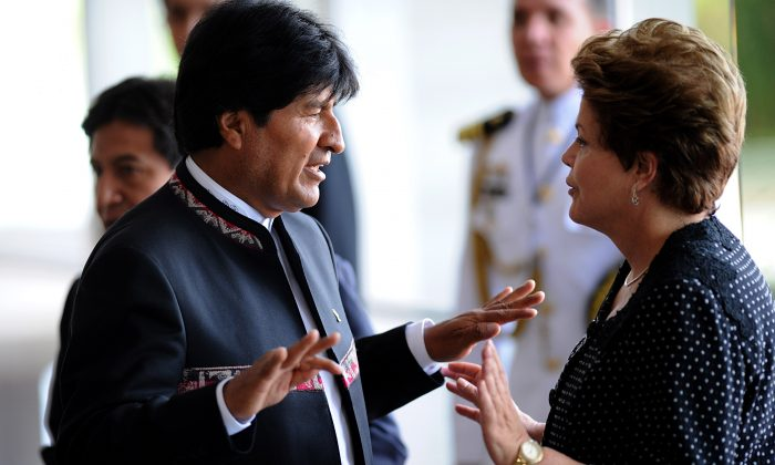 Brazilian President Dilma Rousseff (R) talks with her Bolivian counterpart Evo Morales as he arrives for the Summit of Heads of State of the Mercosur and Associated States in Brasília on Dec. 7, 2012. (Pedro Ladeira/AFP/Getty Images)