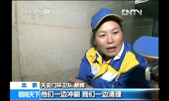 A cleaner is interviewed by China Central Television, about an article featuring trash strewn on the ground on Tiananmen Square, a phenomenon taken as an indication of the popularity of the event by Chinese state media. (Screenshot/CCTV/Epoch Times)