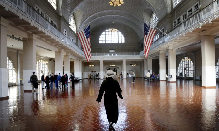 A park ranger walks through the registry room on Ellis Island in New York on Monday, Oct. 28, 2013. (Seth Wenig/AP)
