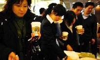In Attack on Starbucks, Chinese Broadcaster Gets Coffee on Face