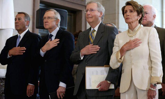(L-R) John Boehner (R-Ohio), Harry Reid (D-Nev.), Mitch McConnell (R-Ky.), Nancy Pelosi (D-Calif.) and Sen. John Cornyn (R-Texas) in Washington, on July 18, 2013. (Chip Somodevilla/Getty Images)