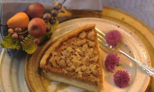 Decadent praline pumpkin pie with cream cheese filling