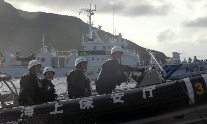Japanese Coast Guard ships are shown near the Senkaku islands, also called the Diaoyu islands. Territorial disputes between China and Japan over the islands are growing more tense. (AP Photo/Emily Wang)
