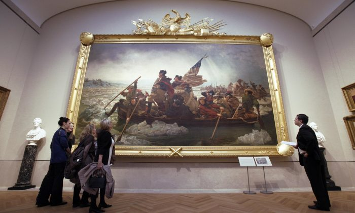 """Visitors at the American Wing of the Metropolitan Museum of Art, New York, Jan., 2012. On display is the painting """"Washington Crossing the Delaware"""" by Emanual Luetze, which commemorates General George Washington's crossing of the Delaware River with the Continental Army on the night of Dec. 25–26, 1776. (Richard Drew)"""