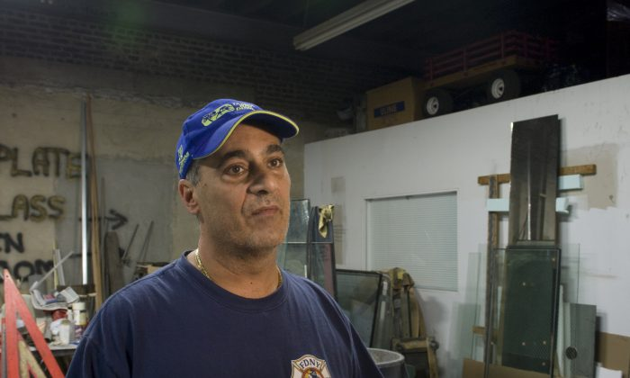 Buddy Civitano, owner of BC Glass, inside his Red Hook business. Both his business and home in Staten Island were untouched by the flooding. (Genevieve Belmaker/Epoch Times)