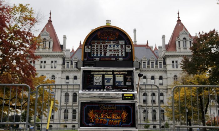 A slot machine sits in front of the state Capitol before anti-casino activists smashed it with a sledge hammer in Albany, N.Y., Oct. 15, 2013. A referendum on allowing casinos in the Catskills will be held Nov. 5. (Mike Groll/AP)