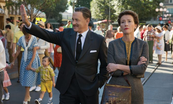 Walt Disney (Tom Hanks) shows Disneyland to 'Mary Poppins' author P.L. Travers (Emma Thompson) in Disney's 'Saving Mr Banks,' releasing in US theaters on December 13, 2013 (François Duhamel)