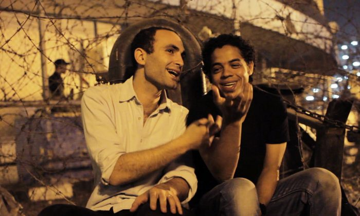 """Egyptian activists Khalid Abdalla (L) and Ahmed Hassan in Jehane Noujaim's documentary """"The Square."""" (Courtesy of Noujaim Films)"""