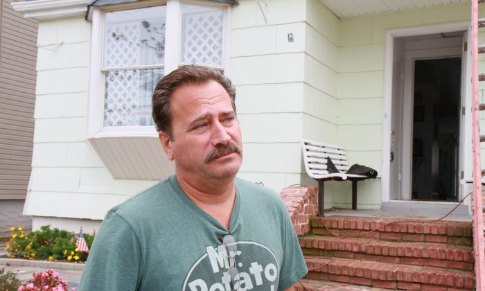 Tasso Calakos outside of his home on Beach 133rd St. in Rockaway, Queens, Oct. 16, 2013. (Milene Fernandez/Epoch Times)