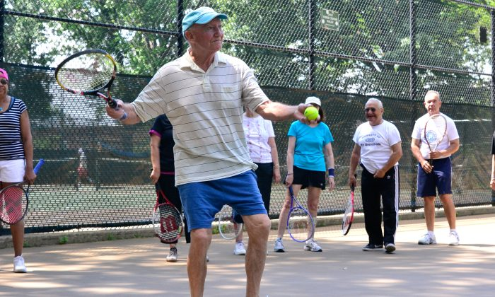 A senior practices his serve during a free tennis course offered by the Parks Foundation. (Justina Wong/Parks Foundation)