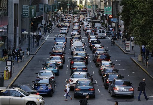 With the BART transit system on strike, traffic is backed up for blocks on Battery Street leading to an artery of the San Francisco-Oakland Bay Bridge during the evening commute Friday, Oct. 18, 2013, in San Francisco. (AP Photo/Eric Risberg)