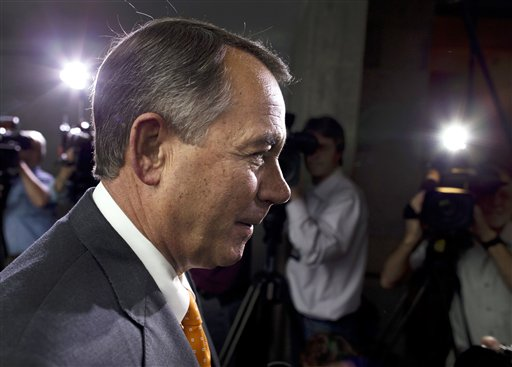 Speaker of the House Rep. John Boehner, R-Ohio, walks past reporters after a meeting with House Republicans on Capitol Hill on Wednesday, Oct. 16, 2013 in Washington. (AP Photo/ Evan Vucci)