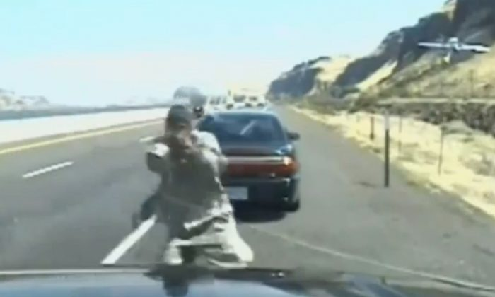 John Van Allen is shown firing on an Oregon State Trooper (Screenshot/YouTube)