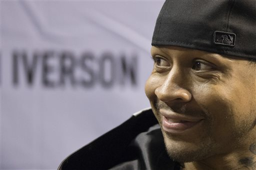 "An article saying Allen Iverson, the ex-Philadelphia 76ers great, was spotted ""begging for change outside [of] Atlanta's Lenox Mall"" is fake. Former Philadelphia 76ers basketball player Allen Iverson smiles during a news conference Wednesday, Oct. 30, 2013, in Philadelphia. Iverson officially retired from the NBA, ending a 15-year career during which he won the 2001 MVP award and four scoring titles. Iverson retired in Philadelphia where he had his greatest successes and led the franchise to the 2001 NBA finals. (AP Photo/Matt Rourke)"
