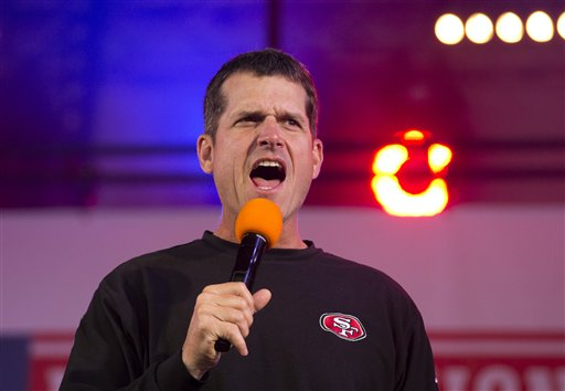 San Francisco 49ers head coach Jim Harbaugh shouts to the fans as he is interviewed on stage during an NFL fan rally in Trafalgar Square, London, Saturday, Oct. 26, 2013.  The San Francisco 49ers are due to play the the Jacksonville Jaguars at Wembley stadium in London on Sunday, Oct. 27 in a regular season NFL game.  (AP Photo/Matt Dunham)