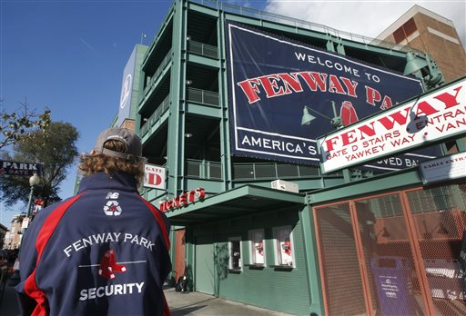 A security guard keeps an eye on things outside Gate D at Fenway Park in Boston, Tuesday, Oct. 29, 2013. If the Boston Red Sox are able to win the baseball World Series at at the stadium, police and city officials want to make sure fans celebrate responsibly. Boston holds a 3-2 lead over the St. Louis Cardinals with Game 6 and if necessary Game 7 scheduled at Fenway for Wednesday and Thursday nights. Police plan to put extra patrols on duty to guard against any unruly celebrations. (AP Photo/Elise Amendola)
