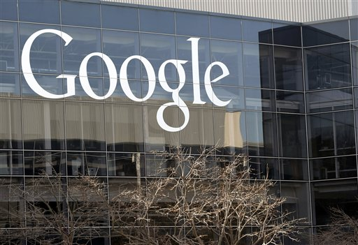 This Jan. 3, 2013, file photo shows a Google sign at the company's headquarters in Mountain View, Calif. (AP Photo/Marcio Jose Sanchez)