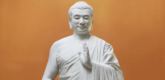 Fiberglass Sculpture (height: 57 inches) 2002, Kunlun Zhang.  This imposing statue of a merciful Buddha is one piece in the Art of Zhen Shan Ren exhibition.