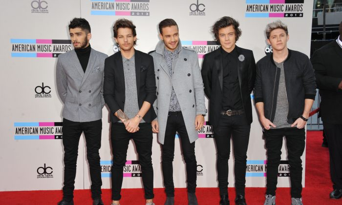From left, Zayn Malik, Louis Tomlinson, Liam Payne, Harry Styles, and Niall Horan of the musical group One Direction arrive at the American Music Awards at the Nokia Theatre L.A. Live on Sunday, Nov. 24, 2013, in Los Angeles. (Photo by Jordan Strauss/Invision/AP)