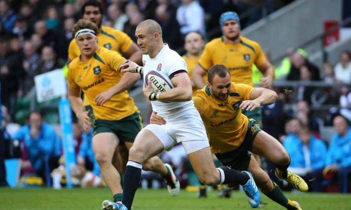 Man-of-the-Match ... Mike Brown of England is tackled by Quade Cooper of Australia during their match at Twickenham Stadium on Nov 2, 2013. (Warren Little/Getty Images)