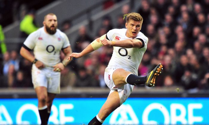 Fly-half Owen Farrell kicks a penalty for England to take a 22-20 lead over the All Blacks at Twickenham Stadium on Nov 16, 2013. New Zealand won the match 30-22. (GLYN KIRK/AFP/Getty Images)