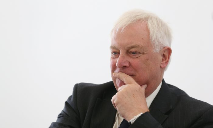 Lord Chris Patten sits in Sculptor Anthony Gormley's studio on Sept. 17, 2013 in London, England. the CCP official mouthpiece People's Daily published an article on Nov. 14 condemning Patten for interfering in Hong Kong's internal affairs. (Oli Scarff/Getty Images)