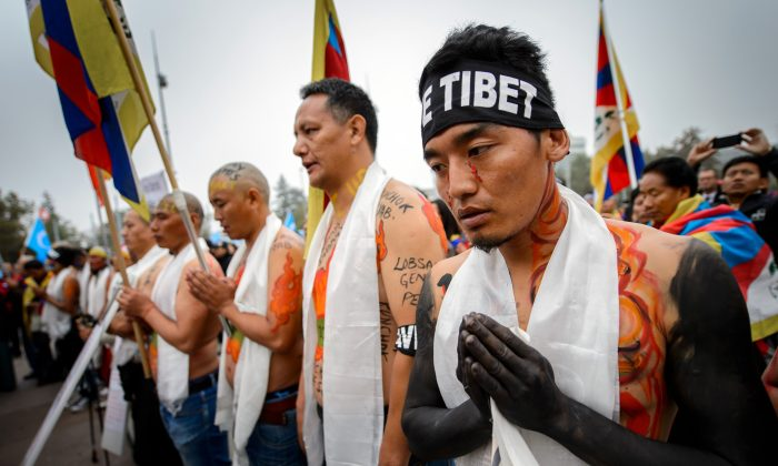 Tibetan activists hold a demonstration on Oct. 22, 2013 outside of the United Nations offices in Geneva. Overseas Tibetans, along with Chinese inside China, have protested the human rights abuses of the Chinese regime in the context of its United Nations membership, and attempts to be a member of the UN Human Rights Council. (Fabrice Coffrini/AFP/Getty Images)