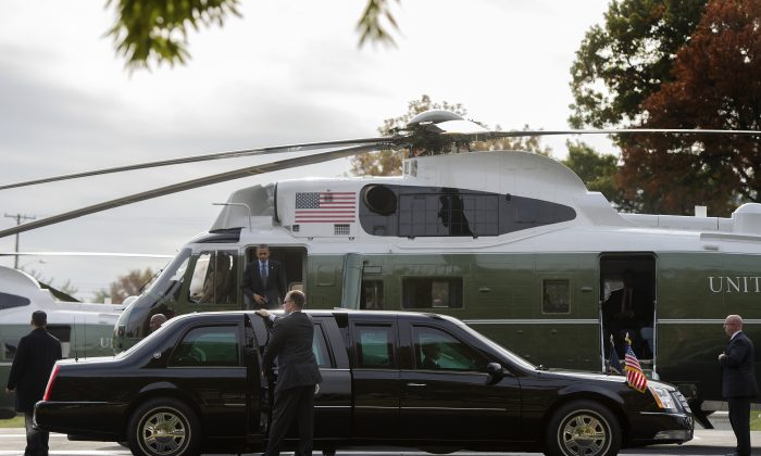 US President Barack Obama (C) walks off Marine One as he arrives at Walter Reed National Military Medical Center in Bethesda, Maryland on November 5, 2013. The standard for securing presidential safety has been upgraded with each administration, and the trend can be traced back exactly 50 years, to the day President John F. Kennedy cruised through downtown Dallas in a rather ordinary 1961 Lincoln Continental.  (JIM WATSON/AFP/Getty Images)