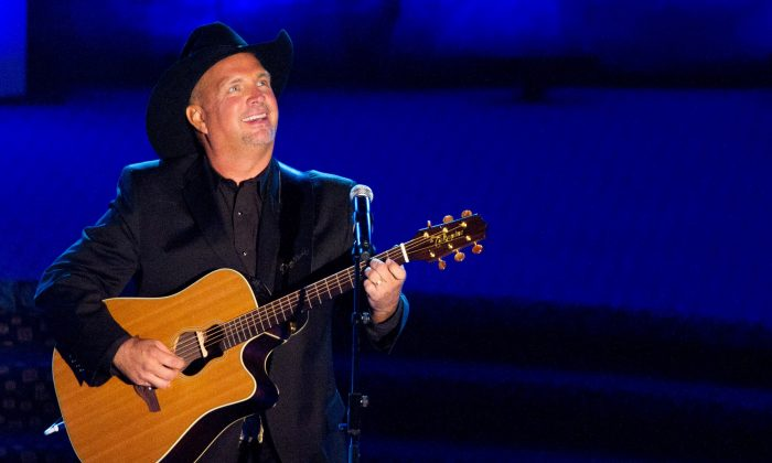 """This June 16, 2011 file photo shows inductee Garth Brooks performing onstage at the 42nd Annual Songwriters Hall of Fame Awards in New York. In stores Thursday, Nov. 28, 2013, is Brook's """"Blame It All On My Roots,"""" eight-disc box set containing a blast of newly recorded material. Brooks heads up a concert special Friday, Nov. 29, 2013, that CBS will broadcast live from the Wynn resort in Las Vegas.(AP Photo/Charles Sykes, File)"""