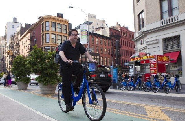 A man rides a Citi Bike nearby Union Square in Manhattan on May 29, 2013. New York City's bike share operator Alta Bicycle Share is dropping its partner Bixi, which recently filed for bankruptcy, for 8D Technologies. (Samira Bouaou/The Epoch Times)
