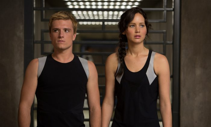 """This image released by Lionsgate shows Josh Hutcherson as Peeta Mellark, left, and Jennifer Lawrence as Katniss Everdeen in a scene from """"The Hunger Games: Catching Fire."""" (AP Photo/Lionsgate, Murray Close)"""