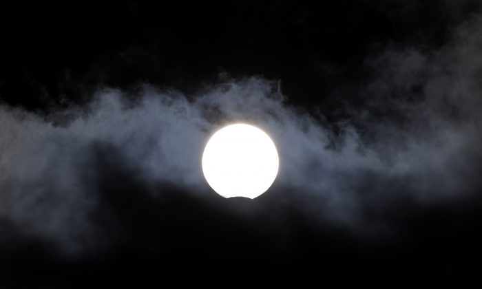 This Friday, there's going to be a rare phenomenon: A supermoon, solar eclipse, and a vernal equinox will take place all on the same day.   (AP Photo/Andres Kudacki)