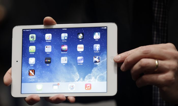 Ipad Air on Tuesday, Oct. 22, 2013, in San Francisco. A Guangzhou woman whose iPad went missing in Europe had to pay Chinese customs 200 yuan ($33) to import it as a new product, after a kind Norwegian man mailed it back to her. (AP Photo/Marcio Jose Sanchez)