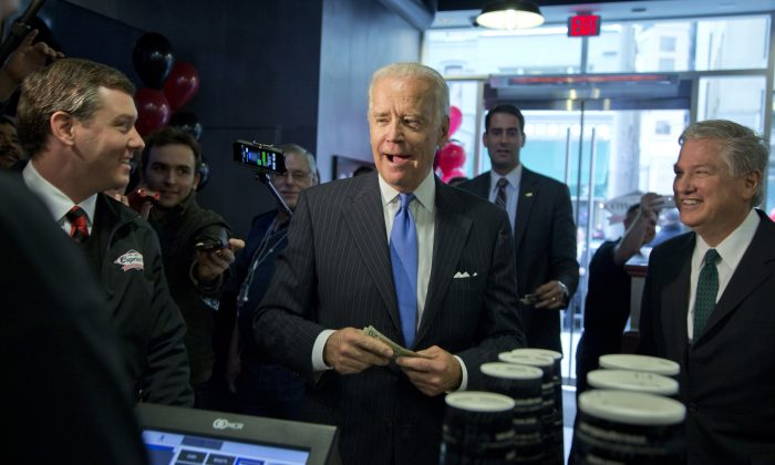 Vice President Joe Biden buys lunch at Capriotti's Sandwich Shop, Thursday, Nov. 21, 2013, in Washington. Biden is a frequent customer of Capriotti's in Delaware. This is Capriotti's first store in Washington. (AP Photo/Carolyn Kaster)