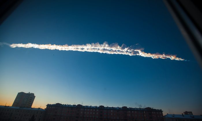 A contrail is left in the sky after a meteor exploded over the Russian city of Chelyabinsk, on Feb. 15, 2013. (AP Photo/Chelyabinsk.ru, Yekaterina Pustynnikova)