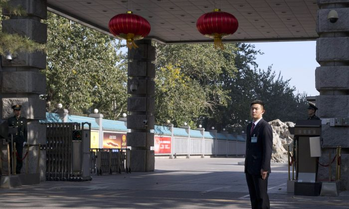 Security personnel on Nov. 7, 2013 guard the entrance to the military-controlled Jingxi Hotel, where the Third Plenum of the Central Committee, a major Communist Party meeting, is being held in Beijing. The meeting goes from Nov. 9-12 and will be used to announce new economic policies. (AP Photo/Ng Han Guan)