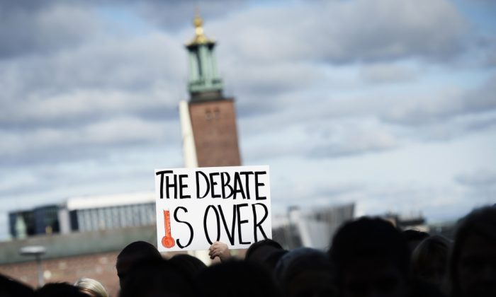 Protesters gather outside the United Nations Intergovernmental Panel on Climate Change (IPCC) in Sweden on Sept. 27, 2013. (Johnathan Nackstrand/AFP/Getty Images)