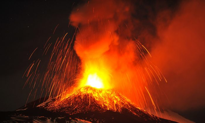 Mt. Etna, Europe's most active volcano, spews lava during an eruption as seen from Acireale, near the Sicilian town of Catania, Italy, on Nov. 16, 2013. It continues to erupt on November 18, along with several other volcanoes around the world. (AP Photo/Carmelo Imbesi)