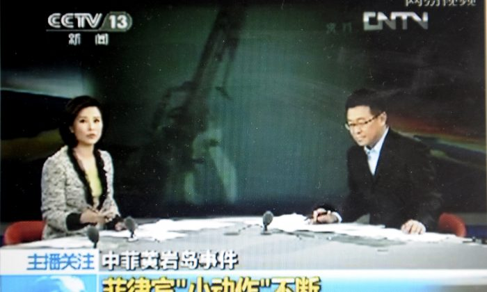 This file photo shows a screen grab from CCTV taken on May 7, 2012. A Chinese blogger points out that the differences between CCTV and Western media are worth a laugh, and some serious thought. (CCTV/AFP/Getty Images)