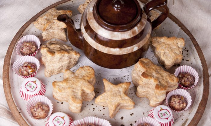 A platter of Whole Wheat Biscuits and Cranberry-Walnut Butter surround a pot of tea. (Cat Rooney/Epoch Times)