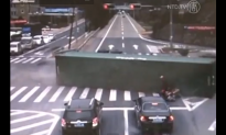 Motorcyclist Narrowly Escapes Overturning Truck in China (Video)