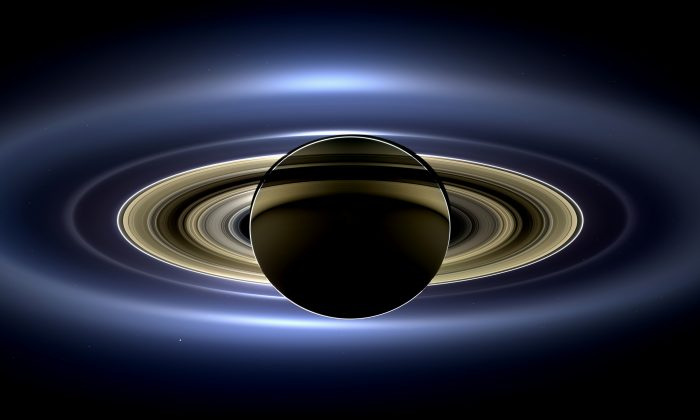 On July 19, 2013, in an event celebrated the world over, NASA's Cassini spacecraft slipped into Saturn's shadow and turned to image the planet, seven of its moons, its inner rings -- and, in the background, our home planet, Earth.  (NASA/JPL-Caltech/SSI)